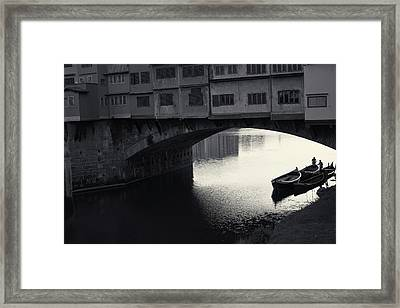Boatmen And Ponte Vecchio, Florence, Italy Framed Print by Richard Goodrich