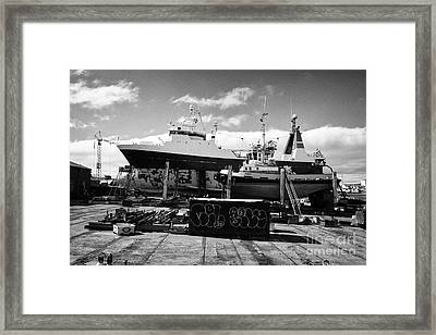 Boats And Ship In Dry Dock In Reykjavik Harbour Iceland Framed Print