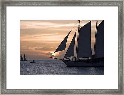 Boats Passing Through Florida Keys Sunset Framed Print by Christopher Purcell