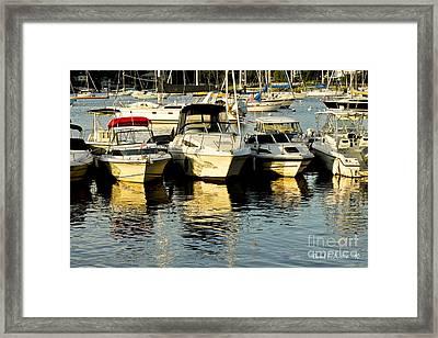 Boats Reflected Framed Print by Carol F Austin