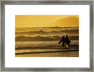 Body Surfers Walk In The Water Framed Print