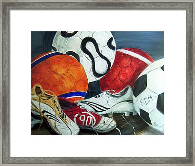 Boots N Balls Framed Print by Pete Maier