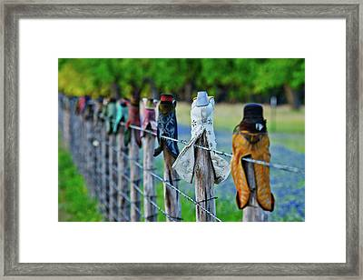 Boots On The Fence Framed Print by Linda Unger
