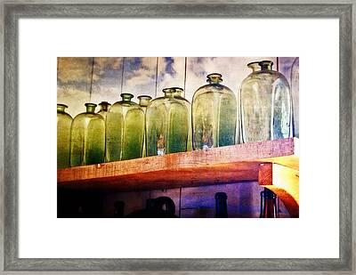 Bottle Row Framed Print by Marty Koch