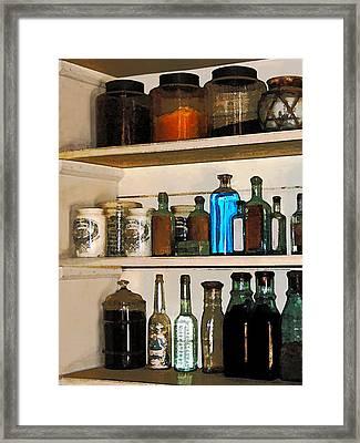 Bottles And Jars Framed Print