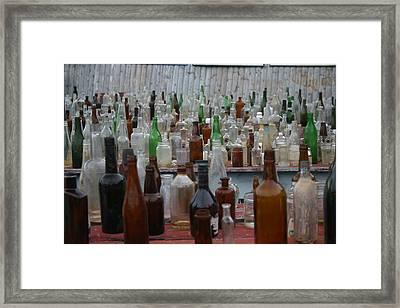 Bottles Framed Print by Dennis Curry