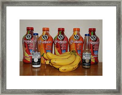 Bottles N Bananas Framed Print by Rob Hans