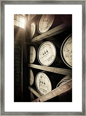 Bourbon Barrels By Window Light Framed Print by Karen Varnas
