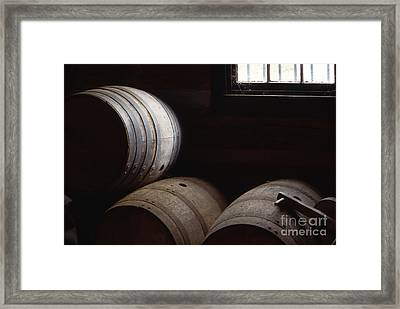 Bourbon Barrels Framed Print by Lowell Anderson