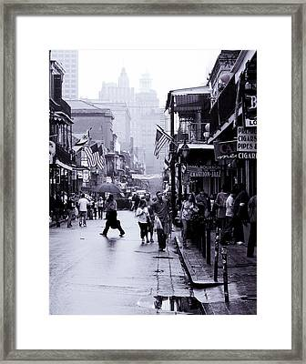 Bourbon Street In The Rain Framed Print by Ray Devlin