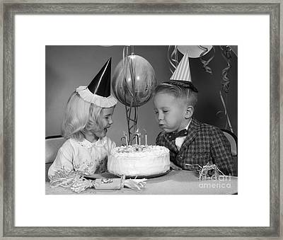 Bow Blowing Out Candles On Birthday Framed Print by H. Armstrong Roberts/ClassicStock