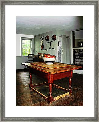 Bowl Of Apple On Table Framed Print by Susan Savad