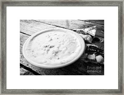 bowl of new england clam chowder and oyster crackers served in a restaurant in Boston USA Framed Print