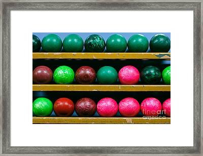 Bowling Balls In Ball Rack Framed Print by Paul Velgos