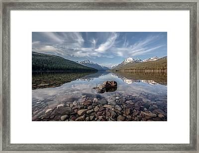Bowman Lake Rocks Framed Print by Aaron Aldrich