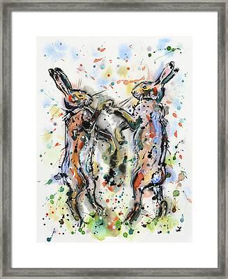 Boxing Hares Framed Print by Zaira Dzhaubaeva