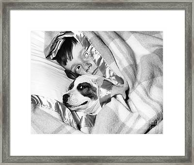 Boy And Dog Hiding Under Blanket Framed Print by D. Corson/ClassicStock