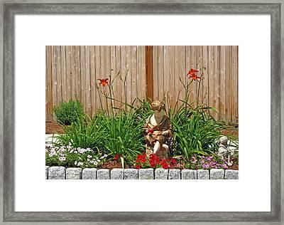 Boy And Dog In Garden Framed Print by Barbara McDevitt