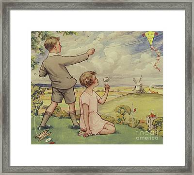 Boy And Girl Flying A Kite Framed Print