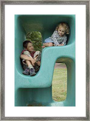 Boy And Girl Playing In Plastic Cube Framed Print