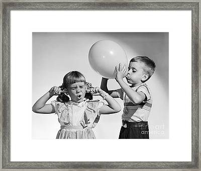 Boy And Girl With Balloon, C.1950s Framed Print by Debrocke/ClassicStock