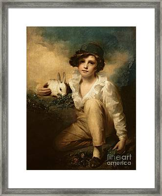Boy And Rabbit Framed Print