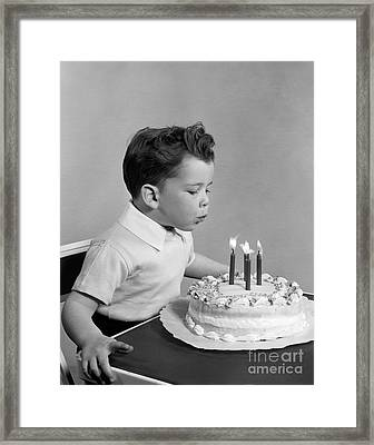 Boy Blowing Out Candles On Cake, C.1950s Framed Print by H. Armstrong Roberts/ClassicStock