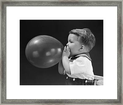 Boy Blowing Up Balloon, C.1940s Framed Print