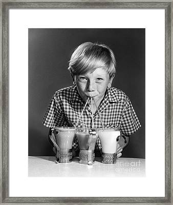Boy Drinking Three Shakes At Once Framed Print by Debrocke/ClassicStock