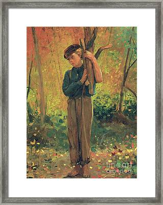 Boy Holding Logs Framed Print by Winslow Homer