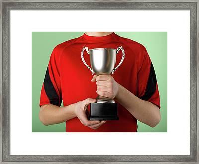 Boy Holding Trophy Framed Print by Jeffrey Coolidge