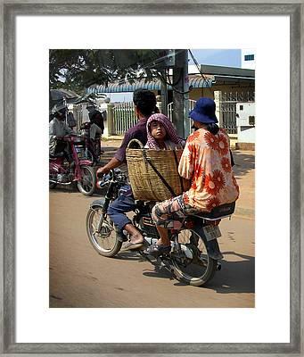 Boy In Basket Framed Print