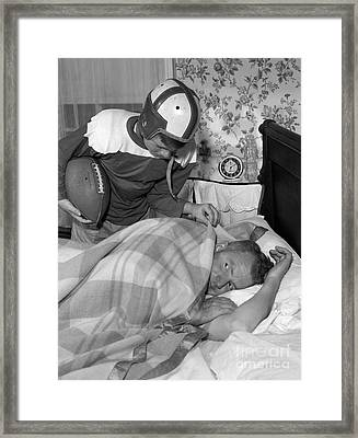 Boy In Football Uniform Waking Framed Print by D. Corson/ClassicStock