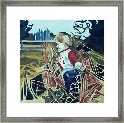 Boy In Grassy Field Framed Print