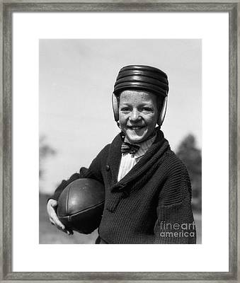 Boy In Old-fashioined Football Gear Framed Print by H. Armstrong Roberts/ClassicStock
