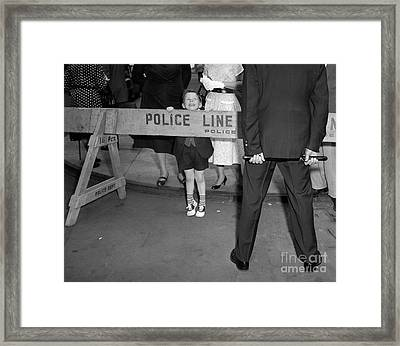 Boy Looking Over Police Line Framed Print by Debrocke/ClassicStock