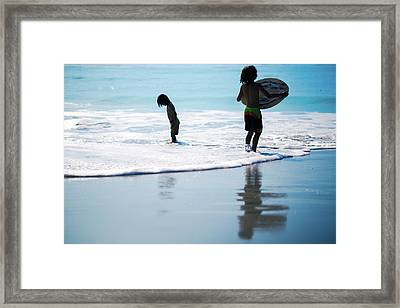 Boy On The Beach With Surf Board,skimboard,and Wave From The Pac Framed Print