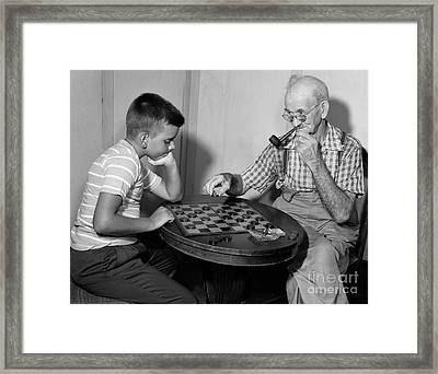 Boy Playing Checkers With Grandfather Framed Print by Debrocke/ClassicStock
