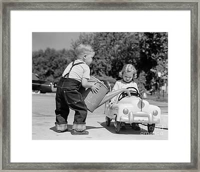 Boy Playing Gas Station Attendant Framed Print