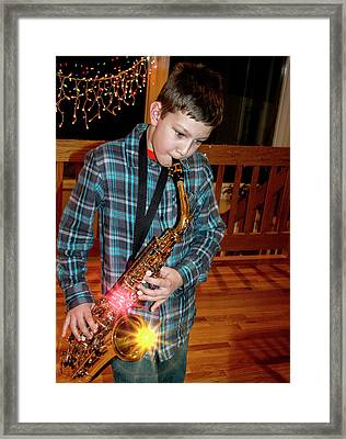 Boy Playing The Saxophone Framed Print