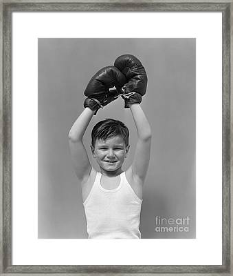 Boy Raising Boxing Gloved-hands Framed Print by H. Armstrong Roberts/ClassicStock