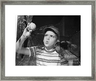 Boy Removes Baseball From Broken Framed Print by Debrocke/ClassicStock
