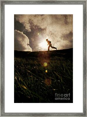 Boy Running Framed Print