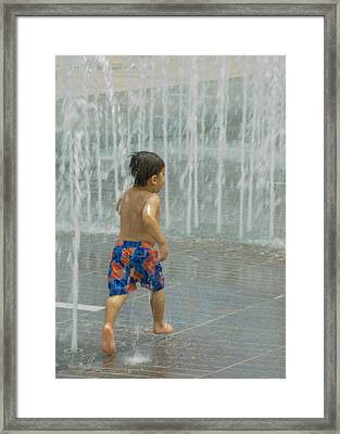 Boy Running In The Water Framed Print by Robert  Suggs