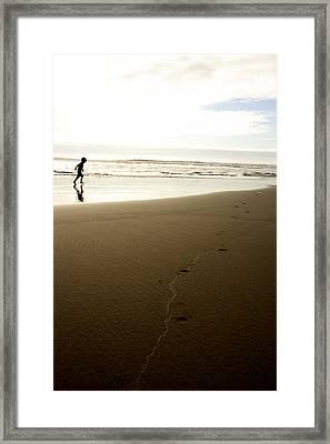Boy Running On The Beach Framed Print
