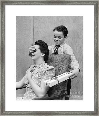 Boy Surprising Mother With Gift Framed Print by H. Armstrong Roberts/ClassicStock