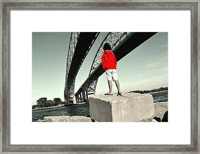 Boy Under Bridge Framed Print