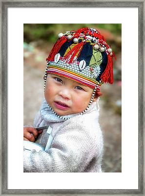 Boy With A Red Cap. Framed Print