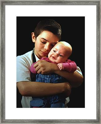 Framed Print featuring the photograph Boy With Bald-headed Baby by RC deWinter