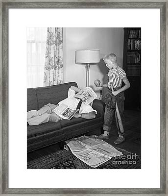 Boy With Baseball Vs. Napping Dad Framed Print by D. Corson/ClassicStock